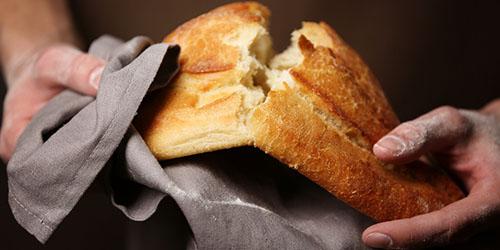 приснилось ломать хлеб