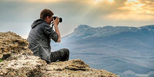 к чему снится фотографировать