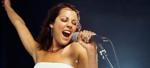 к чему снится петь песни