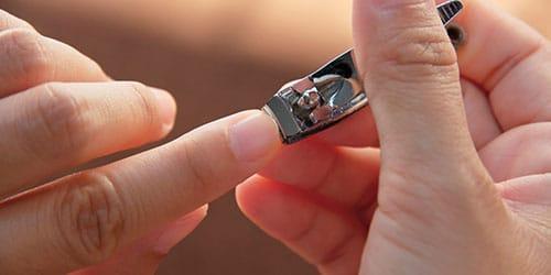 к чему снится обрезать ногти