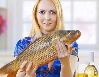 Держать в руках рыбу во сне