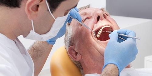 вставлять зубы во сне