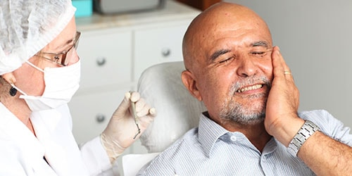выпадают гнилые зубы во сне