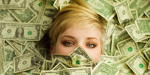 приснилось много долларов